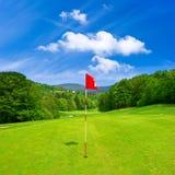 Golf field and blue sky. european landscape. Golf field and cloudy blue sky. european landscape Royalty Free Stock Photos