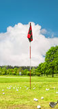 Golf field and cloudy blue sky. Landscape with green grass and t Royalty Free Stock Image