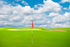 Golf field with cloudy sky background Royalty Free Stock Image