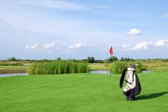 Golf field and golf bag. Golf field with flag and golf bag stock images
