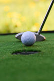 Golf field hole with cross and ball Royalty Free Stock Images