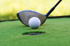 Golf field hole with cross and ball Stock Photography