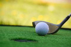 Golf field hole with cross and ball Royalty Free Stock Photos