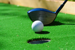 Golf field hole with cross and ball Royalty Free Stock Photography