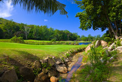 Golf field at island Praslin, Seychelles. Nature background stock photo