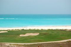 Golf field near beach of the luxury hotel Royalty Free Stock Photos