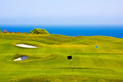 Golf field over the sea. Picture of a golf field over the sea Royalty Free Stock Photo