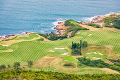 Golf field by the sea Stock Photos