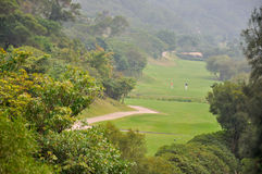 Golf field in valley Stock Photo