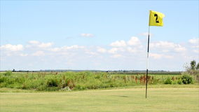 Golf field with yellow flag stock video