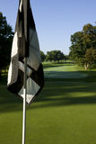 Golf flag. On golf green early one summertime morning Royalty Free Stock Photos