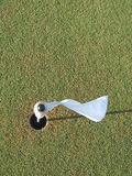 Golf flag. A top down view of a flag/pin inside the cup on a golf course green Stock Image