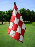Golf Flag. A red checkered golf flag Stock Image