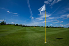 Golf flag active leisure. Golf flag club field grass course active leisure sky royalty free stock image