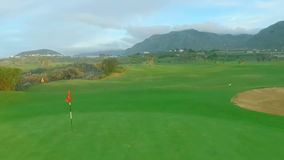 Golf Flag Blowing In Wind On Golf Course. Red Golf Hole Flag Blowing in Wind on the Green stock video