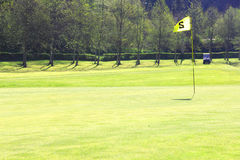 Golf flag on course Stock Photography