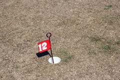 Golf flag in a drought. Royalty Free Stock Images