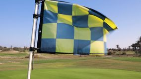 The Golf flag flies. In the wind on a Sunny day stock footage