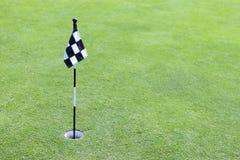 Golf flag on green Stock Photo