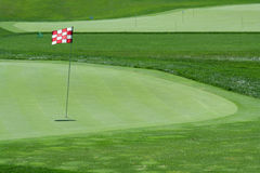 Golf flag on a green Stock Photography