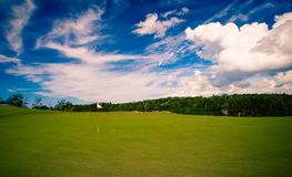 Golf flag on green. White golf flag on a green in Nova Scotia Royalty Free Stock Photo