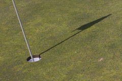 Golf flag shadow. Stock Photography