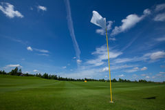 Golf flag sky grass. Golf flag club field grass course active leisure sky royalty free stock photography