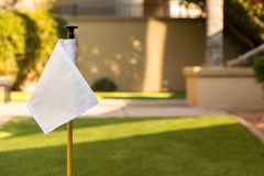 Golf Flag. Small white golf flag in backyard Royalty Free Stock Image