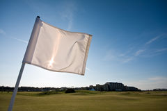 Golf flag on a sunny afternoon. A golf flag blowing in the wind on a sunny afternoon. Photo taken on St Andrews Old Course Royalty Free Stock Image