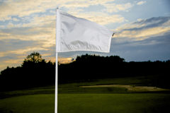 Golf flag at sunset Royalty Free Stock Photo