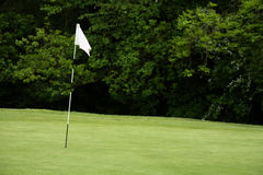 Golf flagpole. Flag pole on a golf green Stock Photo