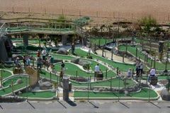 Golf fou sur la plage de Brighton Image libre de droits