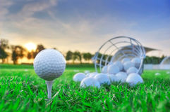 Golf game. Golf balls in grass Stock Photos