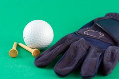 Golf Game. Glove, golf ball and tees Stock Photography