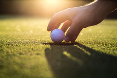 Golf gimme. Golf ball hanging in the sunset stock image