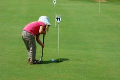 Golf girl. Little girl playing golf Stock Images