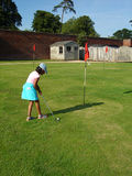 Golf girl. Girl trying to play golf Royalty Free Stock Images