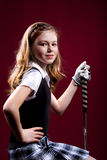 Golf girl. Portrait of a girl with the golfclub Royalty Free Stock Photography