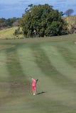 Golf Girl Playing Wedge Shot  Stock Photos