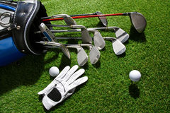 Golf glove,ball and clubs in bag Stock Photo