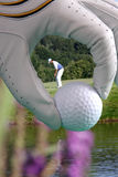 Golf glove with ball and with golfer Royalty Free Stock Images