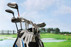 Golf glove and clubs in the bag Stock Photos