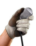Golf glove hand club grooves. Left hand wearing a well-worn golf glove holds club by the head, showing club face and grooves, isolated on a white background Royalty Free Stock Photo