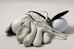 Golf glove, tees, and a golf ball Royalty Free Stock Photography