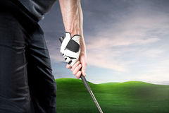 Golf. Er with gloves holds his racket Royalty Free Stock Photos