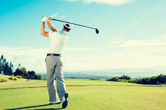 Golf. Er Hitting  Shot with Club on Beautiful  Course on Vacation Royalty Free Stock Photography