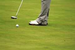 Golf. Er lining up a putt on the  course Royalty Free Stock Photo