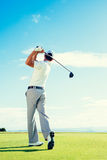 Golf. Er Playing on Beautiful  Course royalty free stock photography