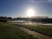 Golf-Golfplatzfahrrinnen und -GRÜNS Lizenzfreies Stockfoto