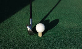 Golf green. Golf ball about to be hit royalty free stock photos